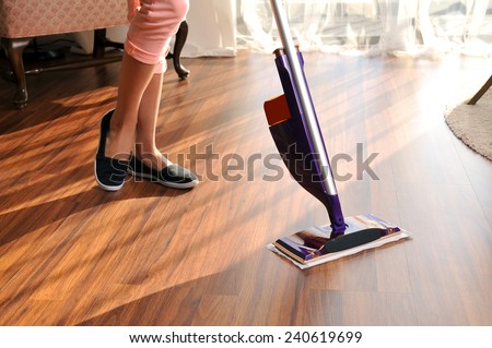 Modern mop for cleaning wooden floor from dust - stock photo