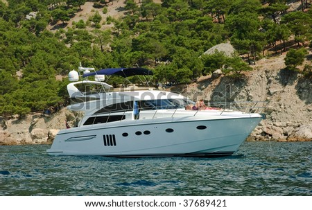 Modern motor boat with peoples - stock photo