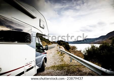 Modern Motor Home Near The Lake. Europe Travel Series. - stock photo
