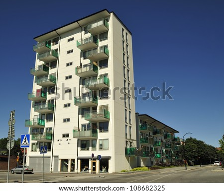 Modern multi-apartments building in summer. - stock photo