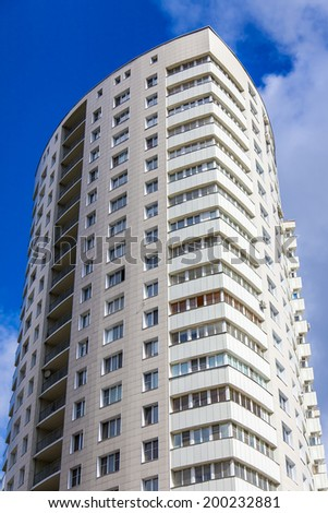 Modern multi-storey residential building - stock photo
