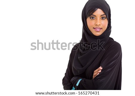 modern Muslim woman looking at the camera over white background - stock photo