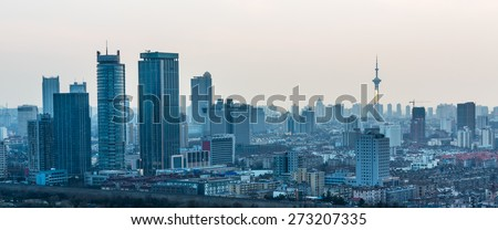 modern nanjing city skyline with the beautiful lake in morning.