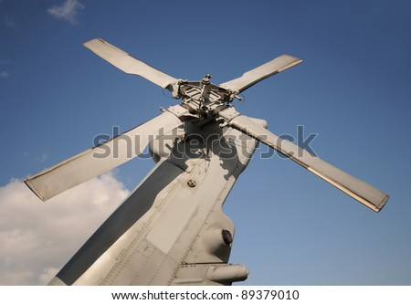 Modern navy helicopter tail assembly and propeller - stock photo