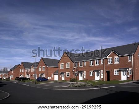 Modern new build street scene of terrace houses in the UK - stock photo