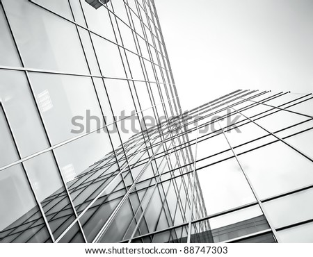 modern new glass high rise corporate building - stock photo