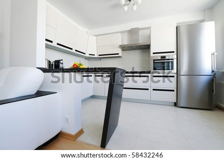 Modern new kitchen luxury interior. No brandnames or copyright objects. - stock photo