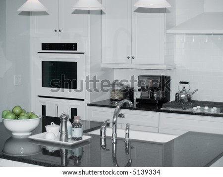 modern new kitchen with center island - stock photo