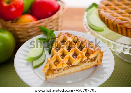 Modern new recipe apple tart pie holiday snack treat served on a plate - stock photo