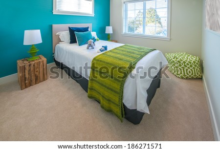 Modern nicely decorated bedroom for children painted in turquoise. Interior design. - stock photo