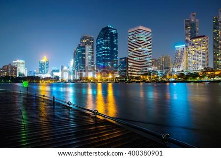 modern night cityscape in Benchakitti Park thailand - stock photo