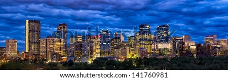 Modern night time shot of  downtown skyline full of skyscrapers - Calgary, Alberta Canada. New symbol of Calgary downtown is visible far left - Bow Building (Encana building). - stock photo