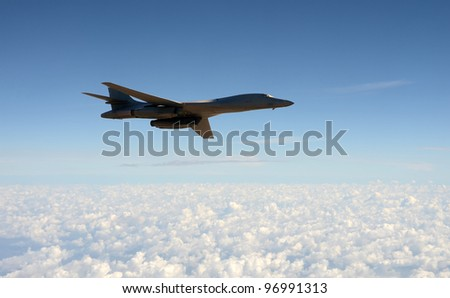 Modern nuclear bomber flying at high altitude - stock photo