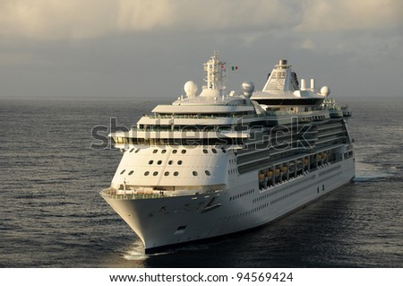 Modern ocean liner approaching port of call - stock photo