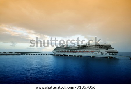 Modern ocean liner in twilight - stock photo