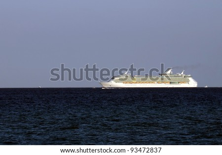 Modern ocean liner on the horizon in open water - stock photo