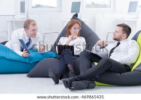 Modern Office Arrangement Business Meeting In Bag Chairs