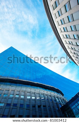 modern office building against the blue sky - stock photo