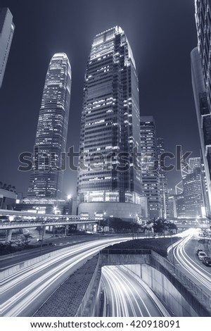 Modern office building and highway in Hong Kong city - stock photo