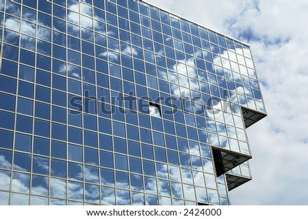 modern office building and the blue sky