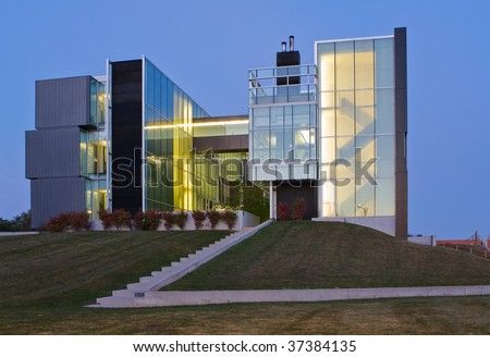 Modern office building at dusk - stock photo