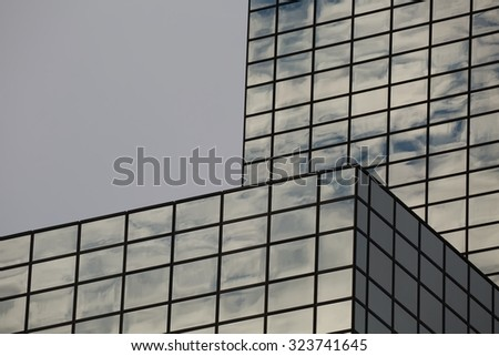 Modern office building detail, glass surface - stock photo