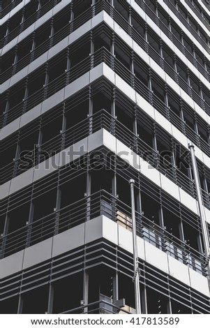 Modern office building detail, windows and floors pattern, minimalistic architectural pattern
