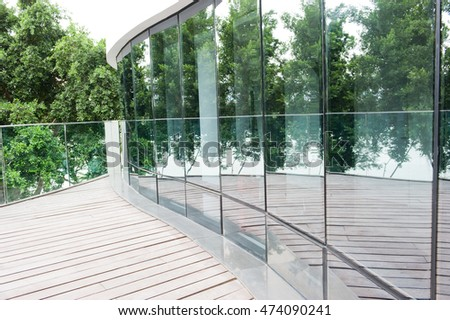 Modern office building exterior with glass wall.
