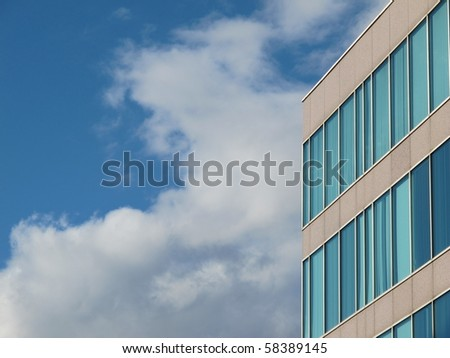 Modern office building exterior  with sky in background. room for copy on left. - stock photo