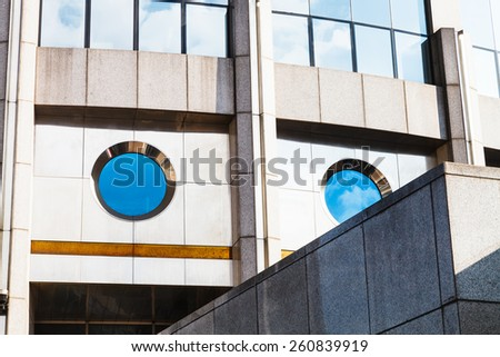 modern office building from concrete and glass in sunny day - stock photo