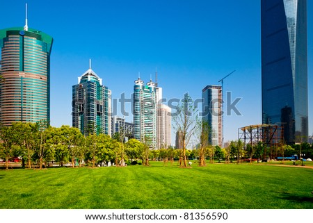 modern office building in dusk of shanghai china. - stock photo