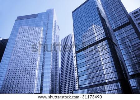 Modern Office Building In Hong Kong, China - Blue Toning - stock photo