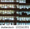 Modern office building in urban city at the night. - stock photo