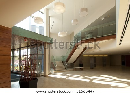 Modern office building lobby in marble, glass and mahogany