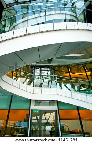 Modern office building with big spiral staircase - stock photo