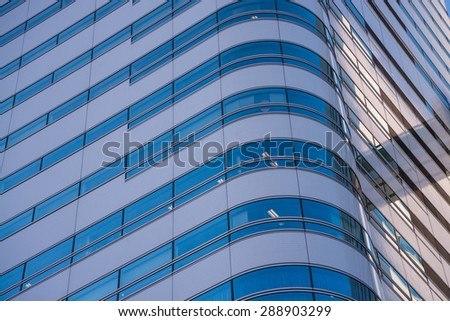 modern office building with blue glass facade - stock photo