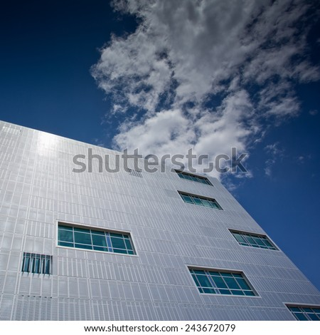 Modern office building with blue sky - stock photo