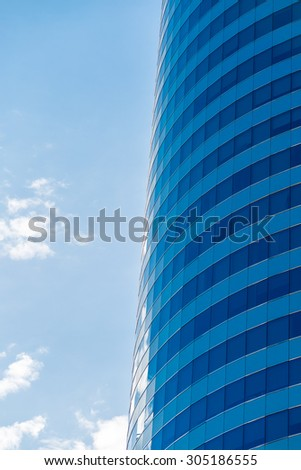 Modern office building with glass reflection background - stock photo
