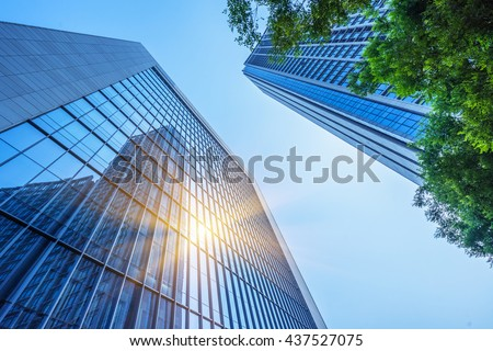 modern office building with green leaves - stock photo