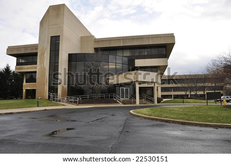 modern office building with many windows and concrete - stock photo