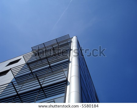 Modern office building with the blue sky background