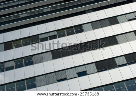Modern office building without sky reflection in windows - stock photo