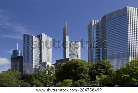 Modern office buildings above the trees in central Frankfurt, Germany