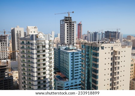 Modern office buildings and hotels are under construction in city Manama City, Bahrain - stock photo