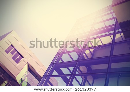 Modern office buildings background, vintage colors style. - stock photo