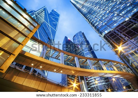 Modern office buildings in central Hong Kong at night.  - stock photo