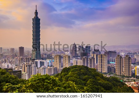 Modern office buildings in Taipei, Taiwan at dusk. - stock photo