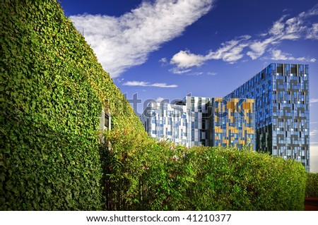 Modern office buildings in the green belt area. - stock photo
