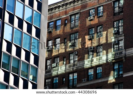 modern office buildings next to an old brick building - stock photo