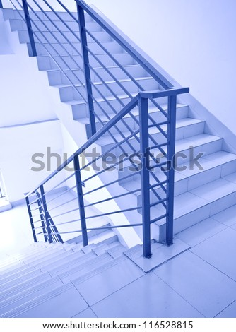 modern office indoor stairs with handrail - stock photo